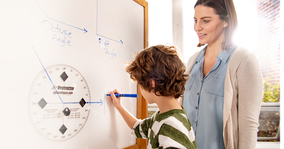 An image of a teacher and student working on a whiteboard.